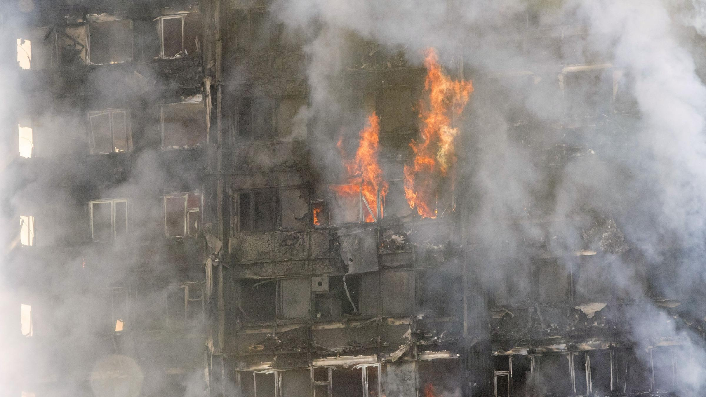 Apartment building engulfed in London with people reportedly trapped inside